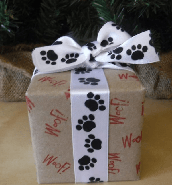 DIY Dog Gift Wrap with red Woof stamp and black and white paw print